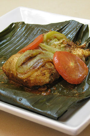 Mexican chicken pibil wrapped in banana leaves