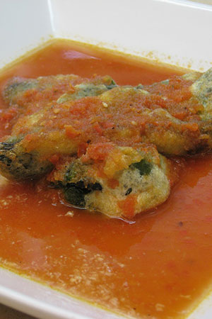 Mexican cheese stuffed poblano peppers in tomato broth