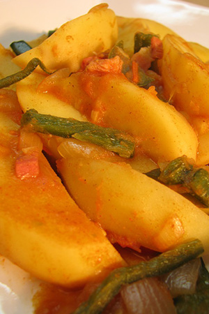 Hungarian paprika potatoes with spicy pepper strips and kolbassa