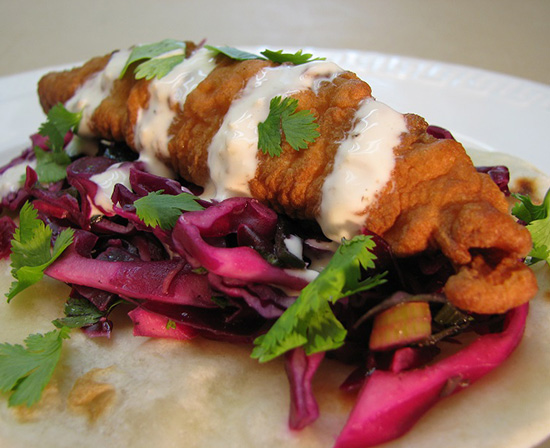 Mexican fried mahi-mahi tacos with cabbage and chipotle crema