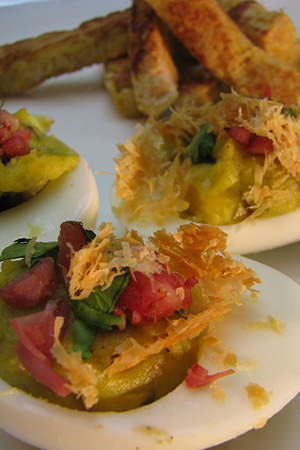 Mexican devilled eggs with avocado, chorizo, cilantro and cheese crisps