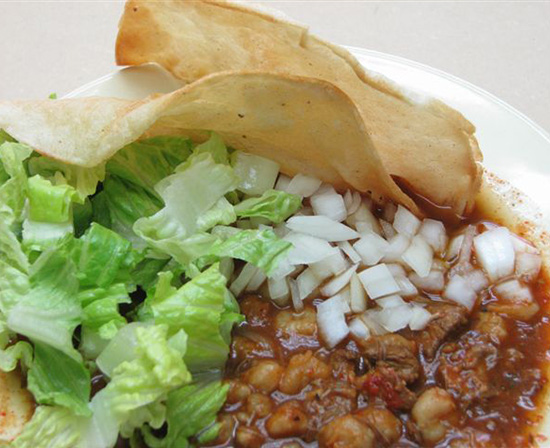 Mexican posole with fried corn tortillas