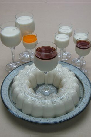 Mexican tres leches gelatin served with liqueurs