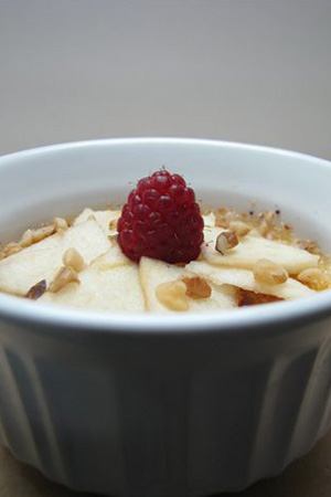 crème brûlée with raspberry, apples and walnuts