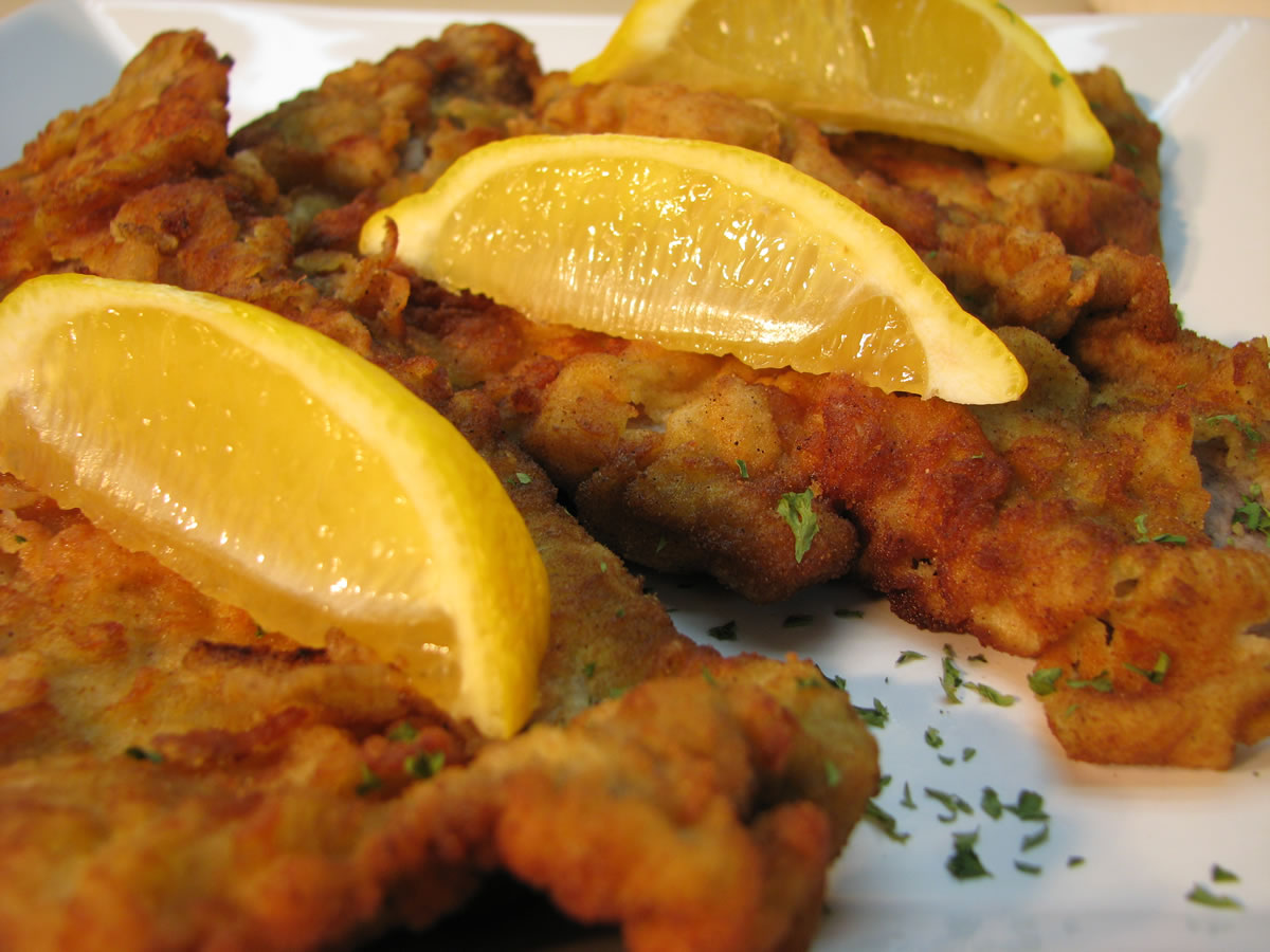 Veal Wiener Schnitzel with lemon wedges