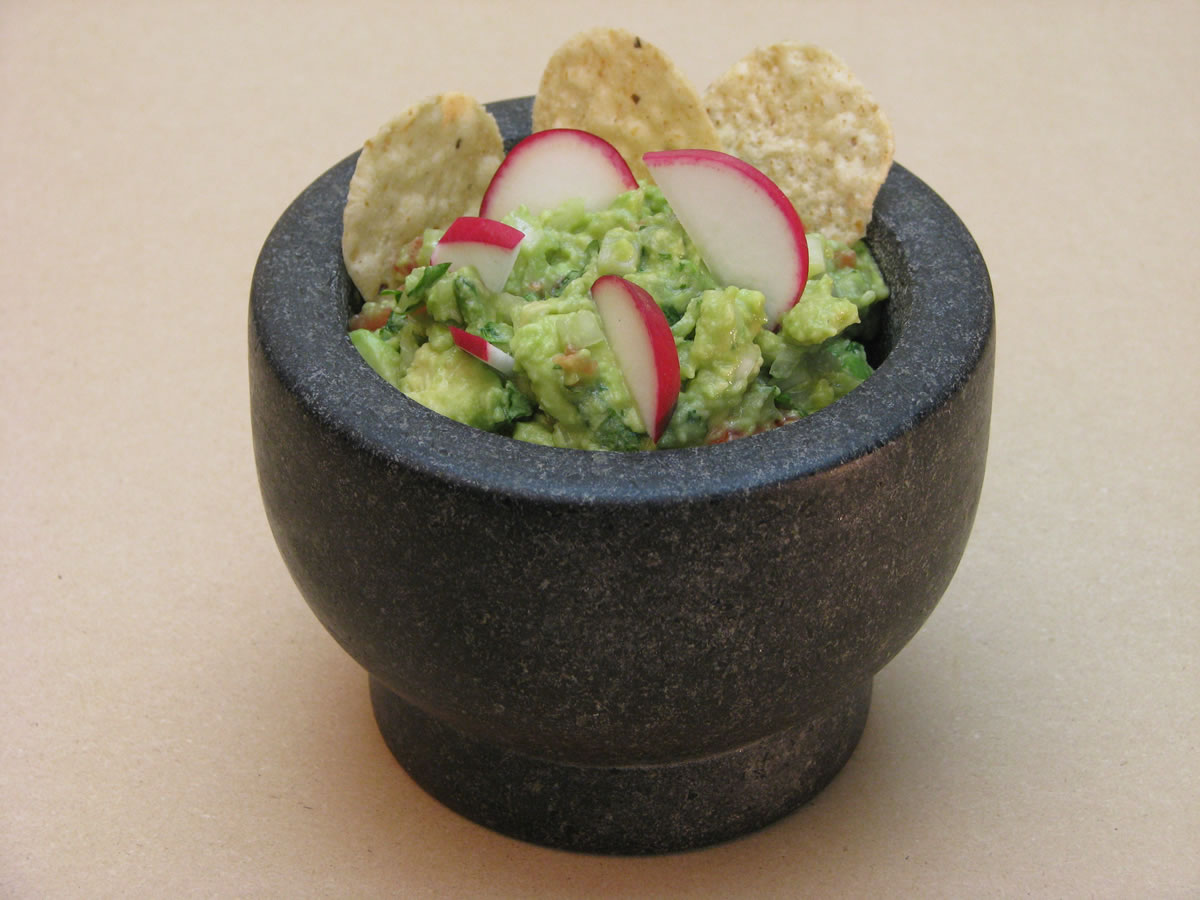 The Best Guacamole You've Ever Had, served with freshly fried tortilla chips